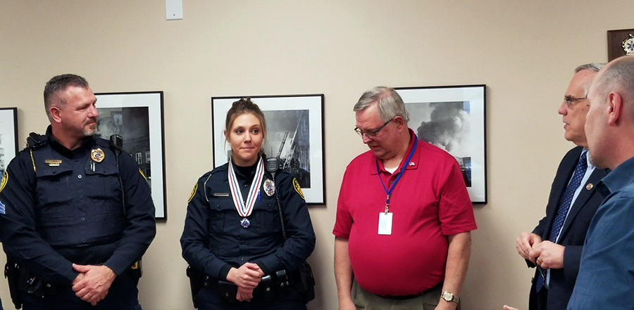 Officer saves life; honored for meritorious conduct