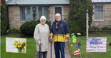 Police, fire, help honor longest-serving volunteer at St. Mike's