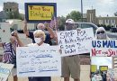Protesters rally outside the post office