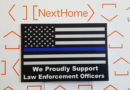 Local realty office offering free law enforcement yard signs
